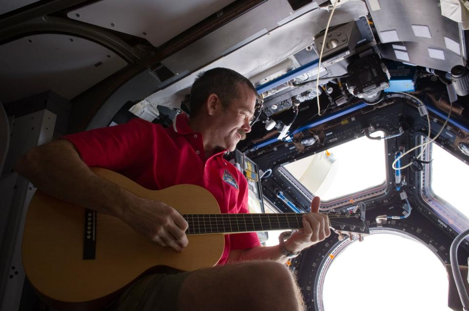 December 25, 2012 - CSA Astronaut Chris Hadfield strums his guitar in the International Space Station's Cupola. Photo Credit: Canadian Space Agency