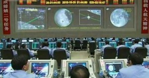 Chinese scientists at the Chang'e 2 orbiter Mission Control, during the orbital mapping of Sinus Iridum, the landing site of the upcoming Chang'e 3. Image Credit: CNTV.