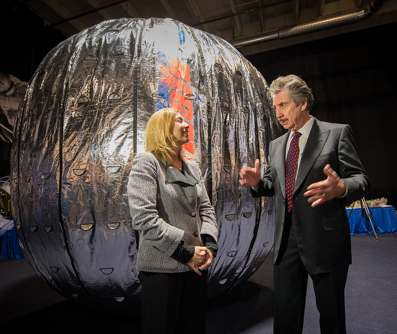 Former NASA Deputy Administrator Lori Garver and Bigelow Aerospace President Robert Bigelow, in front of a full-scale replica of the BEAM module that will be launched to the International Space Station in 2015. Image Credit: NASA/Bill Ingalls.