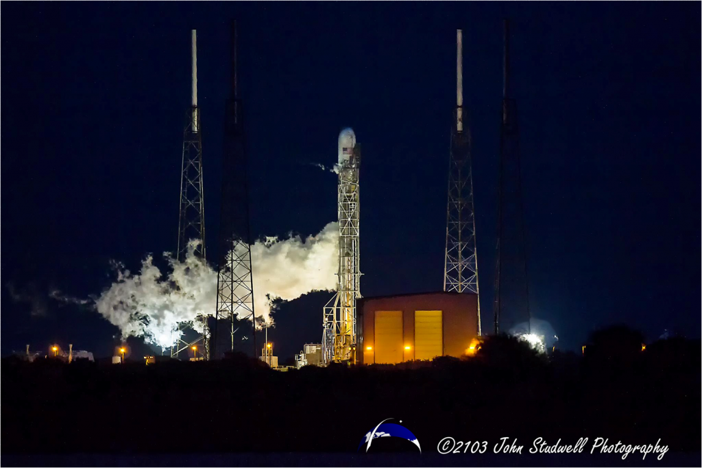 In this photo, the Falcon 9 v1.1 can be seen venting oxygen just after one of the launch attempts which took place Thanksgiving evening. Photo Credit: John Studwell / SpaceFlight Insider