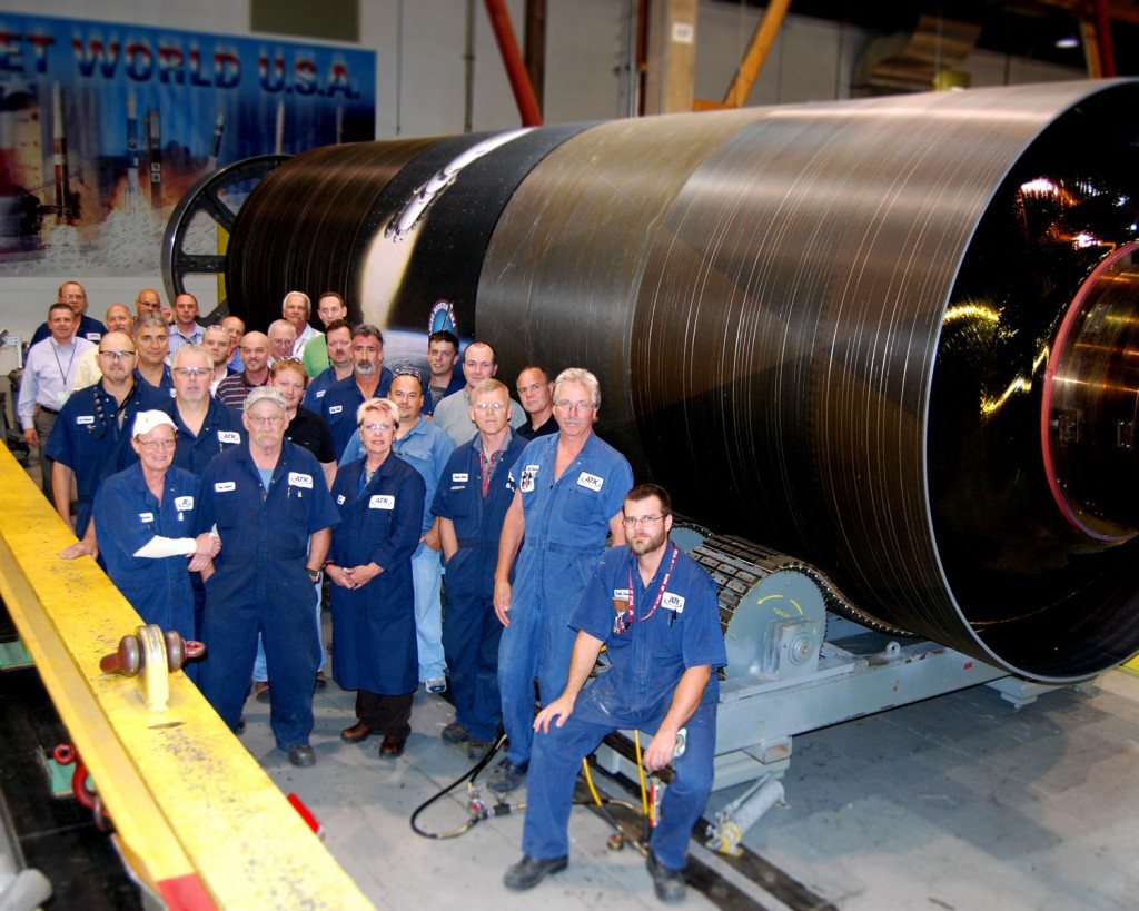 The NRA team poses in front of the freshly-completed Pathfinder booster segment. Photo Credit: ATK